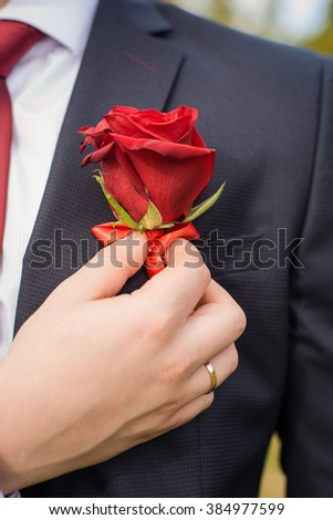 buttonhole on the groom's suit from a rose