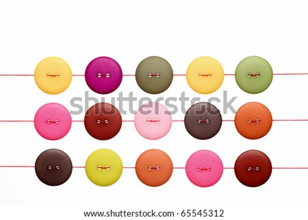 Buttons and thread - stock photo