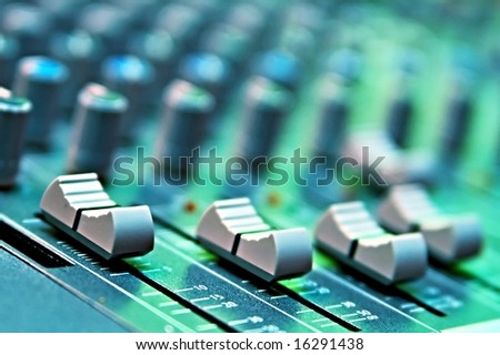 buttons equipment in audio recording studio of the green colour - stock photo