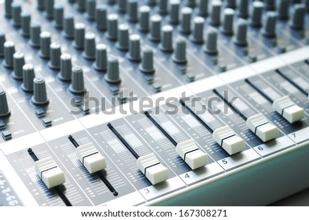 buttons of audio mixer board
