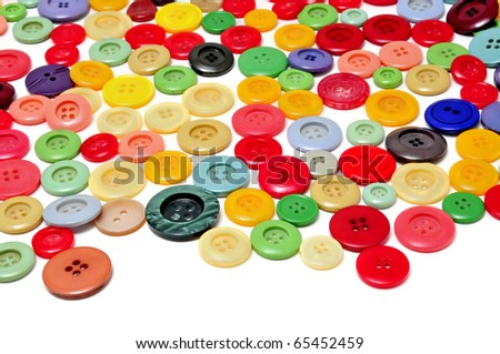 buttons of many colors on a white background - stock photo