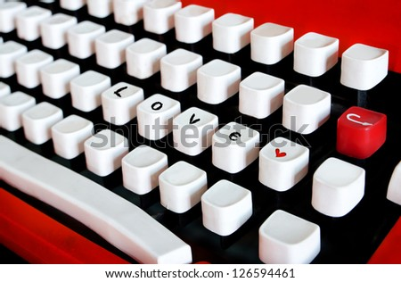 Buttons of vintage typewriter close-up with love word - stock photo
