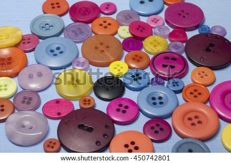 Buttons on Blue Background Close-Up