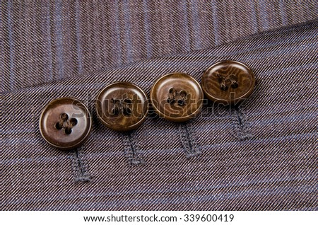 Buttons sleeve of his jacket.  - stock photo