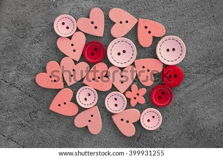 Buttons wooden heart shaped love on a gray background, buttons lot wood, lot of wooden buttons, red buttons, background of buttons