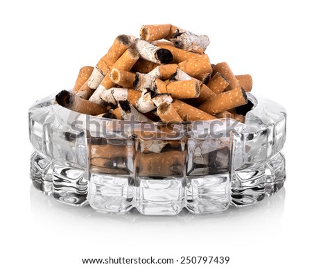 Butts in a glass ashtray isolated on white - stock photo