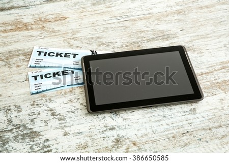 Buy cinema Tickets online with your mobile device or Tablet PC.  - stock photo