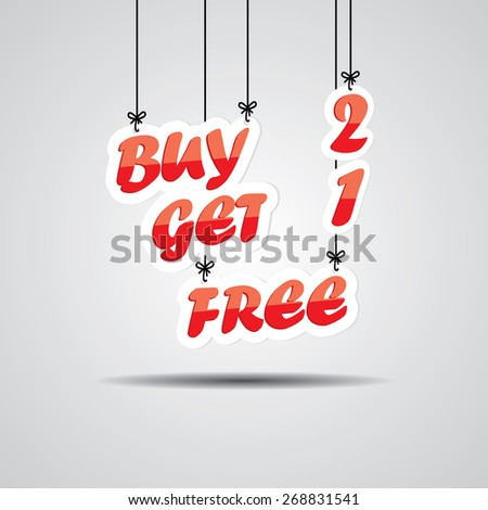 Buy 2 Get 1 Free, Promotional Sale Sign Hanging On Gray Background. - stock photo