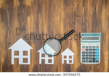 buy house Mortgage calculations,  calculator with Magnifier Searching - stock photo