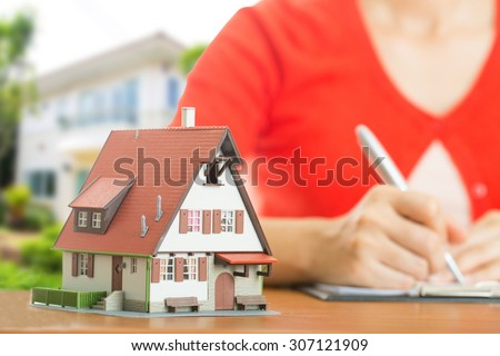 Buy house .Woman calculate and plan for your good property with real agency property - stock photo