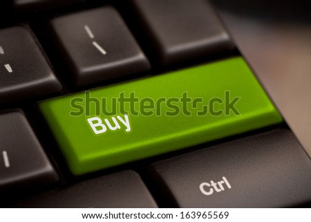 buy key on keyboard showing ecommerce or commerce concept - stock photo