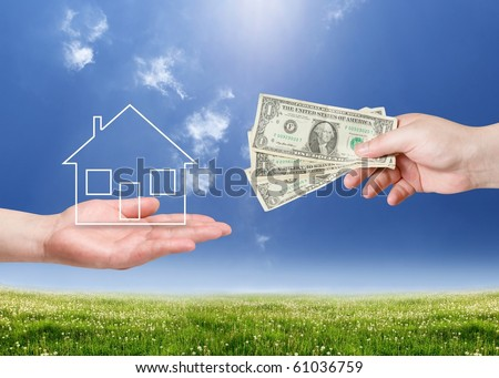 Buy new house concept. Hand with money and house shape over landscape