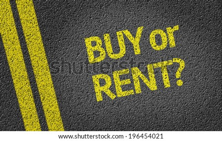 Buy or Rent? written on the road - stock photo