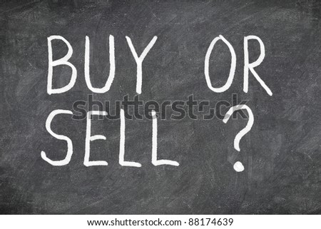 Buy or sell question on blackboard. Buying or selling question mark. Finance, economy, stock or real estate concept - time to buy or sell - stock photo