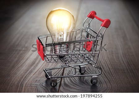 buy smart concept on the wooden background. shopping trolley - stock photo