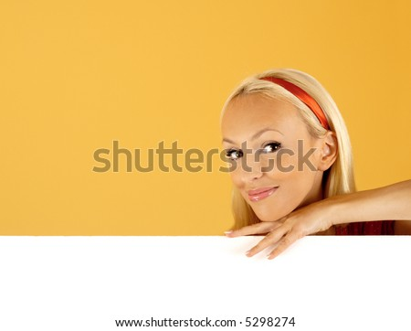 buy this product. Beautiful Young Woman Peeping Over a Banner Over a White Background. good space for writing or placing an image - stock photo