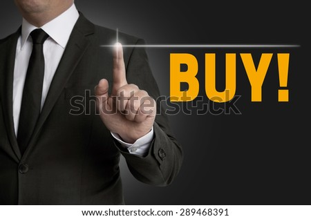 Buy touchscreen is operated by businessman. - stock photo