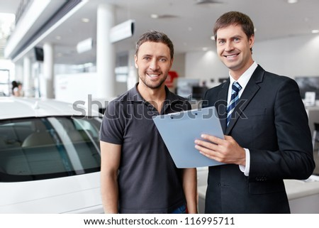 Buyer and seller about cars - stock photo