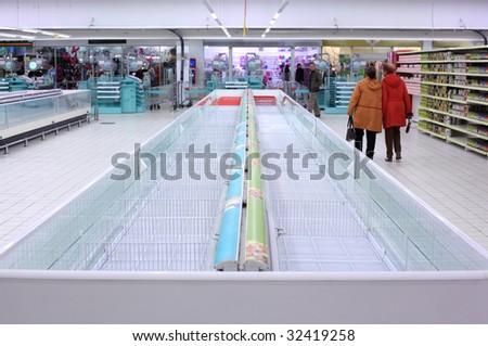 Buyers in empty shop - stock photo