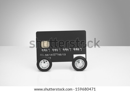 Buying a car concept, Credit card on wheels - stock photo
