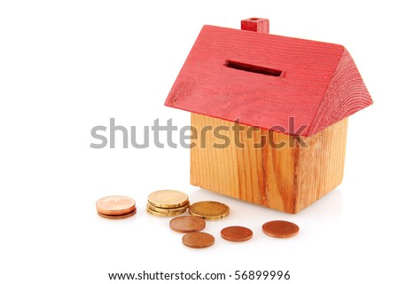 Buying a house with coins isolated over white - stock photo