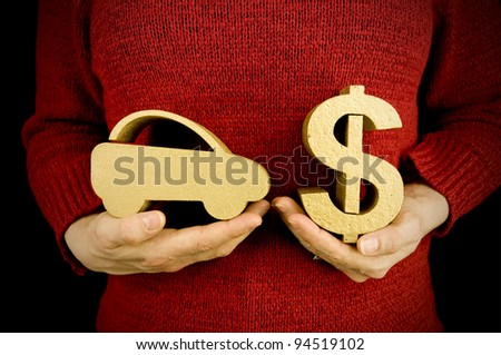 buying car, woman holding gold car and dollar - stock photo