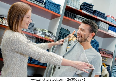 Buying clothes for her boyfriend - stock photo