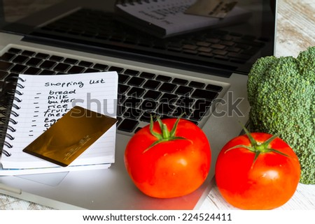 Buying groceries on line with a credit card. - stock photo