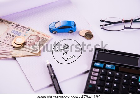 buying home and car concept, indian currency notes, model home, keys, toy car and calculator, isolated