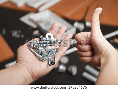 Buying new furniture. Fastening material in the hands against the background of the forthcoming Assembly - stock photo