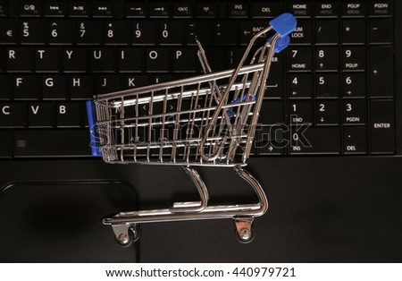 Buying online shopping trolley background - stock photo