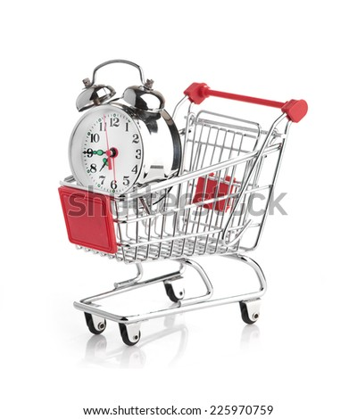 Buying time concept with clock and shopping cart - stock photo
