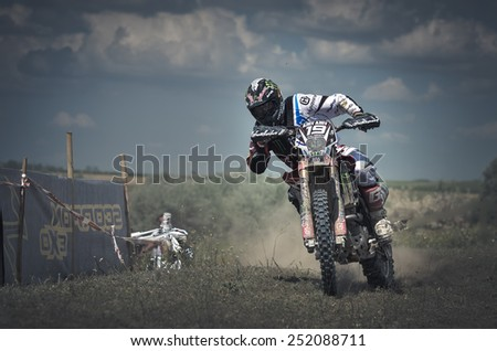 BUZAU, ROMANIA - JUNE 15: An unidentified rider participates in the World Endurocross Championship on June 15, 2013 at Maracineni in Buzau, Romania - stock photo