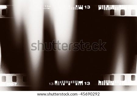 bw filmstrip with light leak background - stock photo