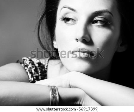 BW portrait of attractive brunette sexy girl over gray - stock photo