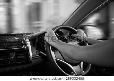 BW tone of Hands of a driver on steering wheel of a car - stock photo