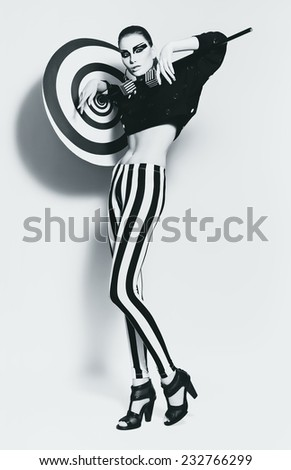 bw woman in black top with spiral umdrella in studio - stock photo
