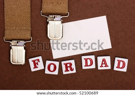By a holiday day of the father man's braces, business a card and inscription For Dad.