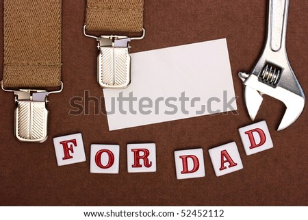 By a holiday day of the father man's braces, business a card, tool and inscription For Dad.