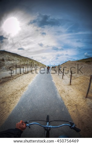 by bike to the beach. Holland, Den Haag, North Sea - stock photo