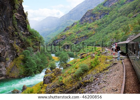 By the train across Scandinavian mountains - stock photo