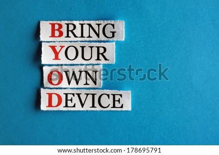 BYOD  acronym  in business concept, words on cut paper hard light - stock photo