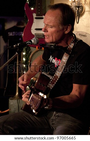 BYRAM, NJ – FEB 9: American singer / songwriter Jonathan Edwards performs at Salt Gastropub on February 9, 2012 in Byram, NJ.  Edwards number one hit is titled 'Sunshine'. - stock photo