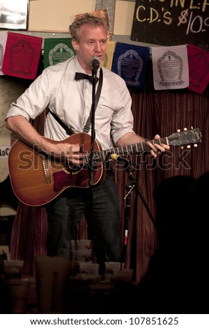 BYRAM, NJ - JULY 12: Chris Barron performs at Salt Gastropub on July 12, 2012 in Byram, NJ. The frontman for The Spin Doctors recovered from vocal cord paralysis and is plans to release a solo album. - stock photo
