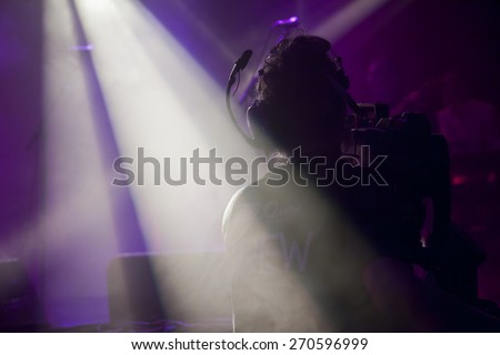 BYRON BAY, AUSTRALIA - APRIL 4 : Cameraman films Crossroads stage at the 2015 Byron Bay Bluesfest. 26th annual Blues and Roots festival. - stock photo