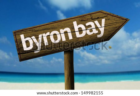 Byron Bay, Australia wooden sign with a beach on background - stock photo