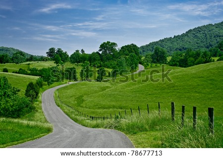 Byway:  A less-traveled road winds through the foothills of the Blue Ridge Mountains in western Virginia. - stock photo