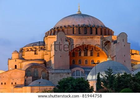 Byzantine architecture of the Hagia Sophia (The Church of the Holy Wisdom or Ayasofya in Turkish) illuminated at dusk, famous historic landmark and world wonder in Istanbul, Turkey - stock photo