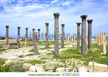 Byzantine Church terrace at Umm Qais, Jordan. The site of the ancient town of Gadara  include baths, two theaters, a ippodrome, colonnaded streets, aqueducts, a temple, a basilica and other buildings. - stock photo