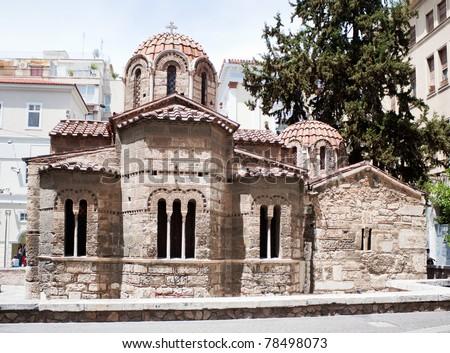 Byzantine Kapnikarea orthodox church in Monastiraki, central Athens, in the corner of Ermou and Kalamiotou, Greece. - stock photo